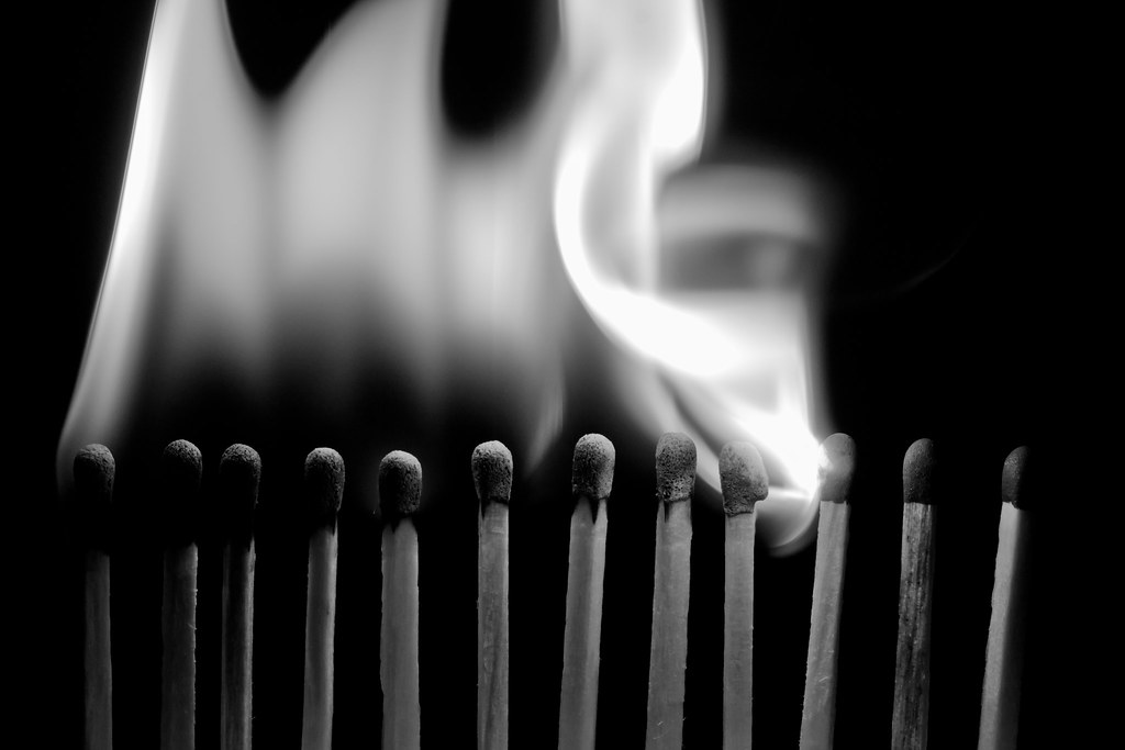 Row of matches with flame spreading from each to the next
