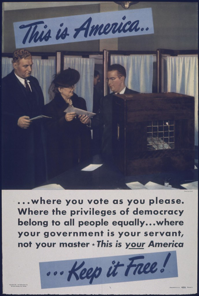 """WWII era poster showing voters at a polling station, with the message: """"This is America... where you vote as you please. Where the privileges of democracy belong to all people equally... where your government is your servant, not your master. This is your America... Keep it Free!"""""""