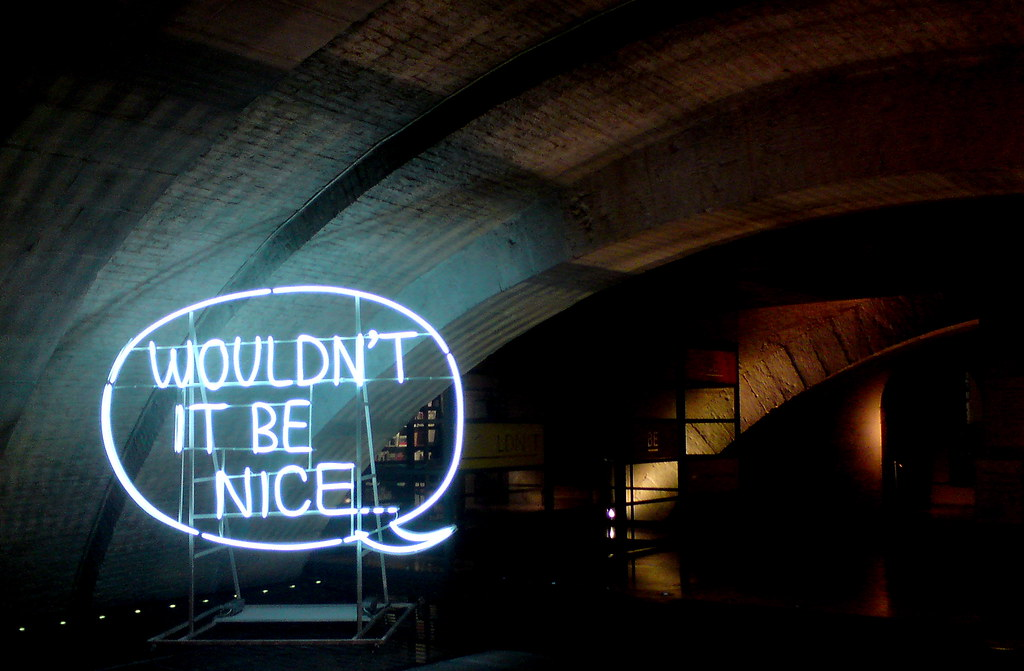 "Neon speech bubble reading ""Wouldn't it be nice..."""