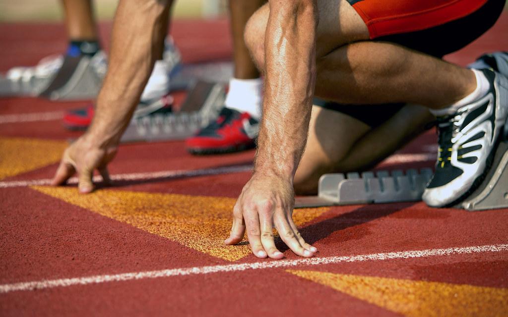 Athlete in starting blocks at beginning of a sprint