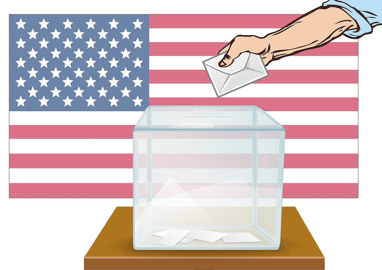 Drawing of hand depositing ballot into box in front of American flag