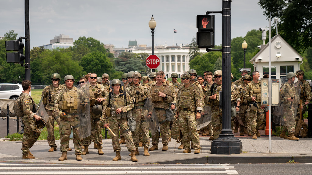 A contingent of military special forces with the White House in the background