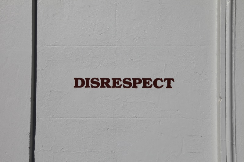 Wall with the word disrespect painted on it