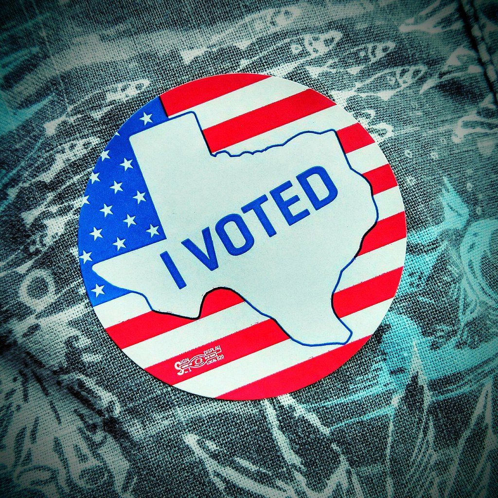 """I Voted"" sticker with outline of Texas on American flag"