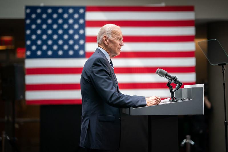 President Joe Biden standing at a podium